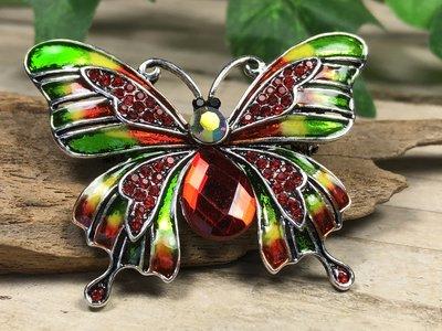 broche vlinder rood-groen