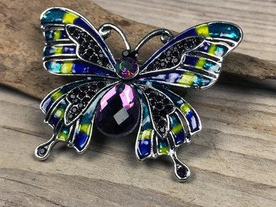 broche vlinder zilverkleur-paars