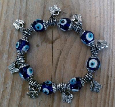 armband blauwe oog met vlinder bedels