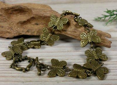 armband vlindertjes bronskleur