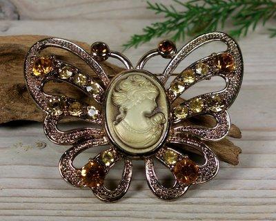 broche vlinder camee goudkleur