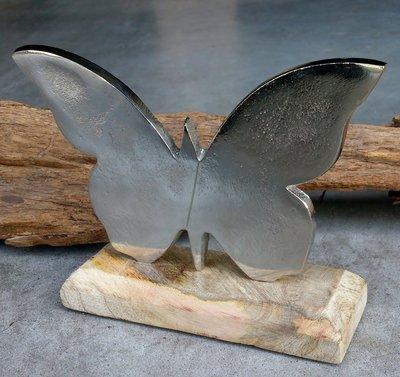 vlinder metaal op houten voet