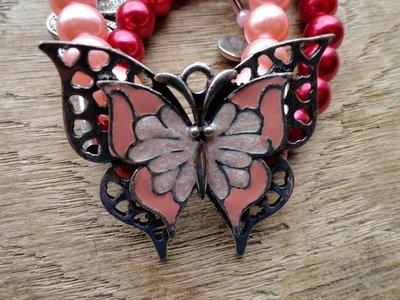armband vlinder roze