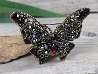broche vlinder brons-rood