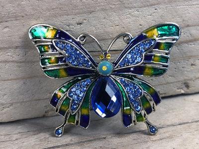 broche vlinder zilverkleur blauw