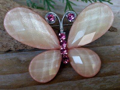 broche vlinder champagne-roze