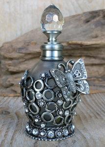 parfumflesje met vlindertje