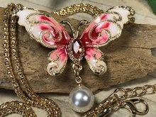 vlinder broche hanger