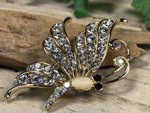 vlinder broche goudkleur